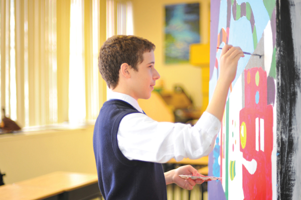 A student painting a mural