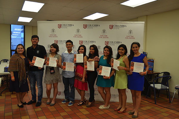 A group of students with achievement certificates posing for the camera
